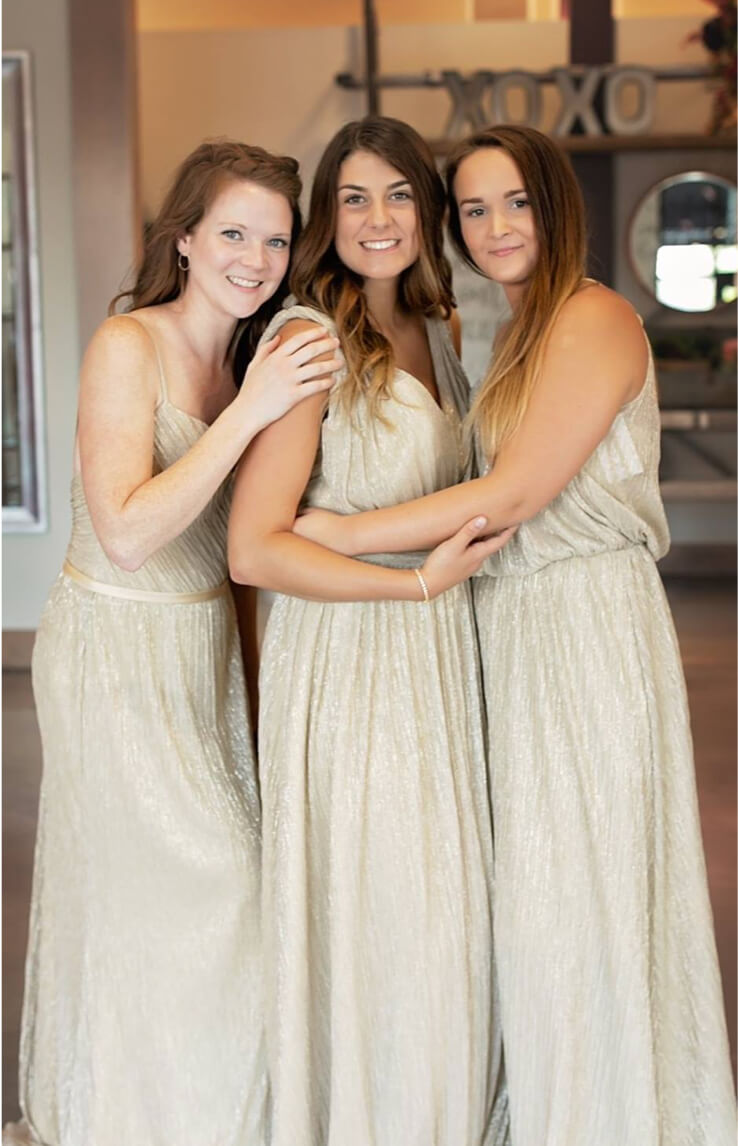 Bridesmaids in beige dresses
